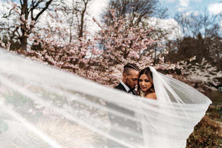 Editorial photo with bride and groom behind a veil