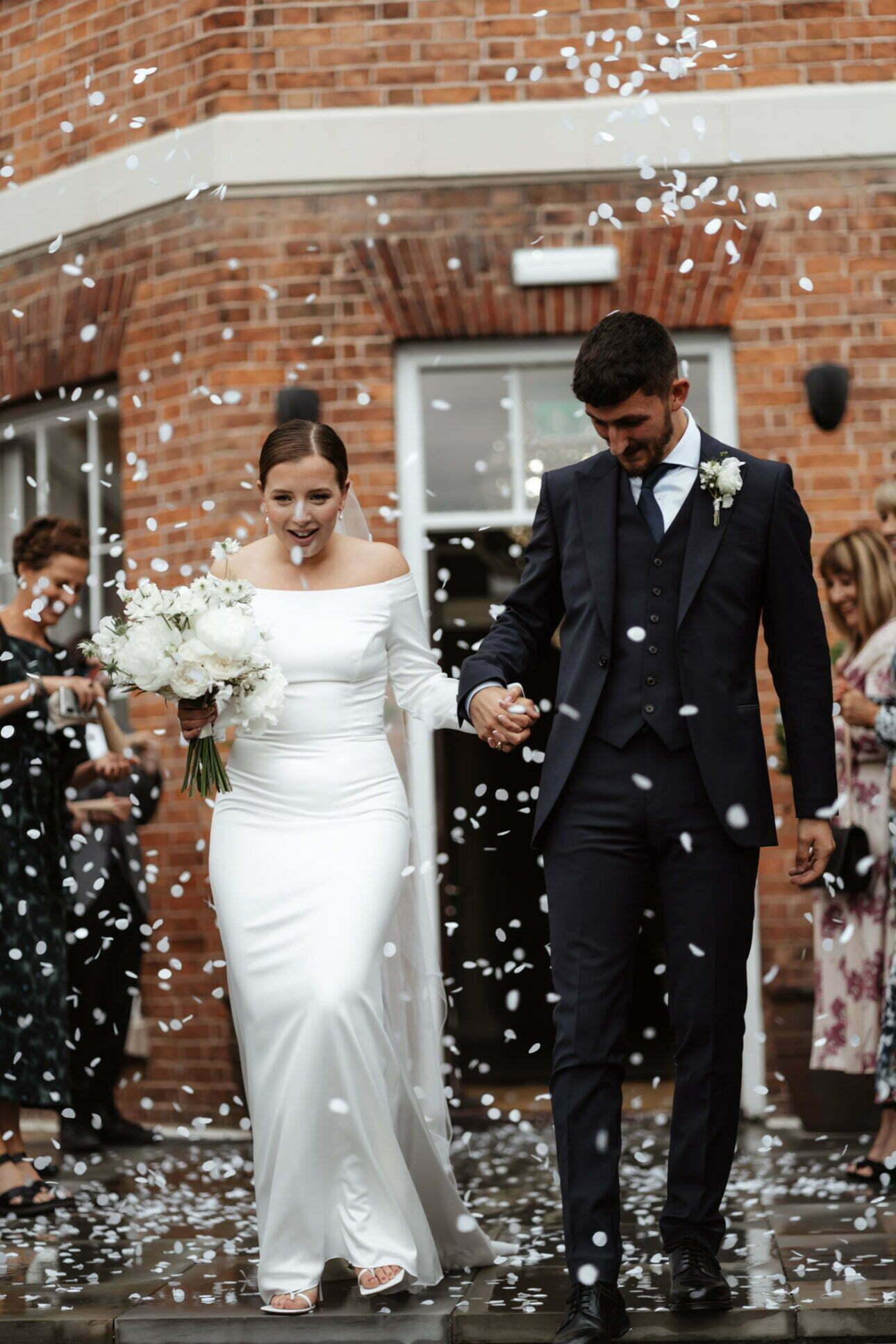 Happy couple walking through confetti